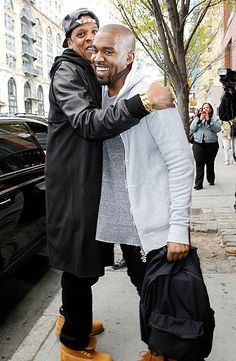 Jay-Z and Kanye West hugged it out in the streets of New York City Apr. 22.