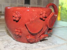One of a kind hand thrown coffee cup.  Has flowers added for a raised dimension.  Rustic Red color. by GabiLuBoutique on Etsy
