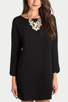 Shift dresses are so comfortable and cute! This versatile long sleeve black dress will be your everyday go-to piece whether it's for work or running errands! Dress it up with a statement necklace and