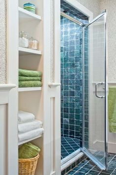 A new shower enclosure, made possible by the demolition of an awkward powder room, now features towers of open shelving to keep fresh towels at the ready.