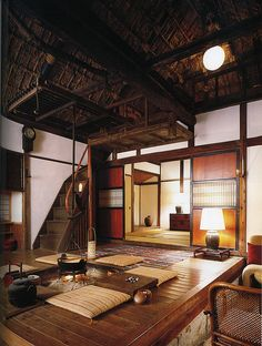 Interior of Japanese country house, with central fire pit and thatched ceiling. A rural farmhouse restored by Kenji Tsuchisawa, on the border of Tochigi and Ibaraki prefectures. (Higher res version.)