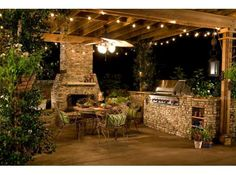 Great looking patio with cooking area and great fireplace.