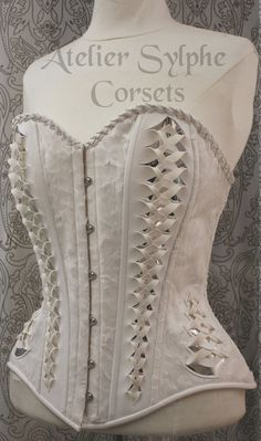 Handmade overbust fashion Sylphe corset with plastic silver detail on velvet and PVC fabric  French workshop Atelier Sylphe corsets. Hand                                                                                                                                                                                 Mais