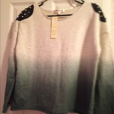 Sweatshirt with spikes on shoulders size large Gray and dark gray sweatshirt size large the shoulders have leather patches with spikes on each one Oxford circus Tops Sweatshirts & Hoodies