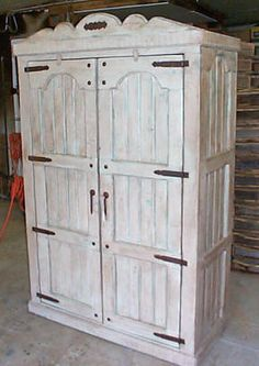 Lovely white and turquoise armoire from Rodeo Rustic Furniture in Albuquerque, NM