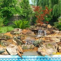 Here's a cool Waterfall we built on the side of an existing in-ground Liner Swimming Pool. Most any existing Pool can be retrofitted with a Waterfall. Natural Swimming Pools, Pool Waterfall, Building A Pool, Spring Nature, Outdoor Landscaping, Golf Courses, Backyard, Pool Ideas, Cabin Ideas