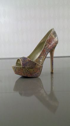 Now Available from Carlos by Carlos Santana shoes - http://www.heels.com/womens-shoes/sexy-gold.html