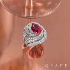 """5,440 Likes, 37 Comments - Graff Diamonds (@graffdiamonds) on Instagram: """"Sparkling spiral A swirl of diamonds presents a stunning 3.94ct pear shape pink sapphire in this…"""""""