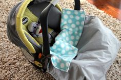 DIY- car seat & stroller blanket. There are also ties on each side, so that you can tie it onto the car seat or the stroller so those wiggly little feet don't kick it off.   -I might have to make this for Maddy. :)