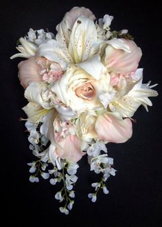Weddbook is a content discovery engine mostly specialized on wedding concept. You can collect images, videos or articles you discovered  organize them, add your own ideas to your collections and share with other people - This romantic bride's bouquet features multiple types of flowers in feminine, soft shades of blush and cream. There are blush calla lilies and hydrangeas, cream roses, tiger lilies and wisteria with ivory hydrangeas.    Note: This item is made to order. Please allow…