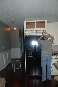 wine rack above fridge