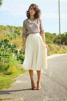 Street style   Beige sweater, cream pleated midi skirt, heels, statement necklace
