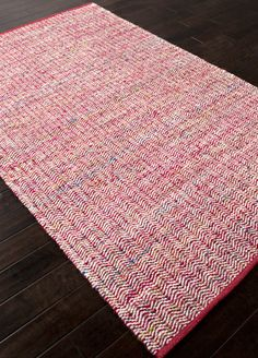 Woven recycled Sari silk is mixed with un-dyed wool to create a blanket of texture and color.  The rugs are reversible making them versatile as well as soft and comfortable.