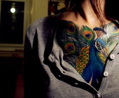 peacock tattoo. love the feathers.