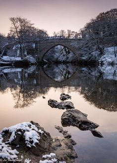 Winter reflects in the waters at Brig O Balgownie, Aberdeen, Scotland