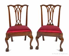 Pair of Philadelphia Chippendale mahogany dining chairs, ca. 1770, each with a pierced gothic splat and cabriole front legs terminating in ball and claw feet.