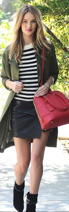 Rosie Huntington-Whiteley�s red handbag, white stripe sweater, black leather skirt, gold jewelry, and suede wedge boots