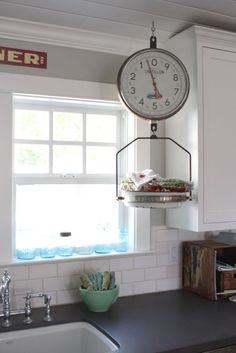 vintage finds on the pleated poppy - love this idea - old scale to hold dish towels & doesn't take up counter-space!