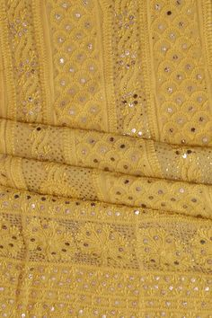This image shows a lovely bright yellow Chikan Dress Anarkali with golden mukaish and hand embroidered kamdani work to add glitter to the outfit. We can also stitch and customise dresses.