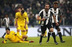 Juventus' forward Gonzalo Higuain from Argentina celebrates after scoring during the UEFA Champions League football match Juventus Vs GNK Dinamo Zagreb on December 7, 2016 at the 'Juventus Stadium' in Turin.  / AFP / MARCO BERTORELLO