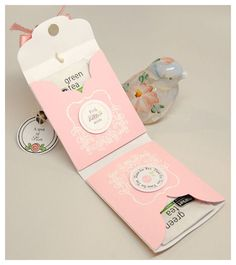 Create a template, stamp or use deco paper, then place two tea bags in it for a sweet party favor to take away from your tea party.