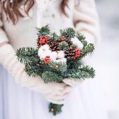 Christmas tree branches and tiny pinecones... Could even put in some baby's breath so it's like yours