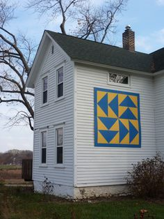 "Barn quilt at Citizens for Conservation Headquarters.  The quilt square pattern is known as ""Flying Geese"" and mimics the official pantone  colors of the Village of Barrington Hills."