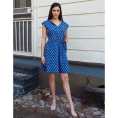 This lovely number has a fit and flare cut – just slip it on and be ready to hit the town! Our Blue Lemon Drop Dress has an easy feminine look and a retro flair with a drop shoulder cap sleeve and a removable belt to give it a nice waist. Plus, it's got pockets!