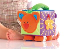 Introduce your little one to the soft and cuddly characters. Shake the soft toy so your baby can hear the gentle rattling sounds and demonstrate the rustling parts. Let your child feel the beans inside the animal's feet and belly and demonstrate the squeak. http://blossomforchildren.co.uk/toys-books/111-farm-activity-play-cube.html