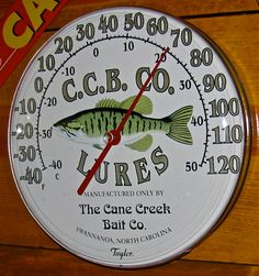 C.C.B. Co. Lures Round Advertising Fishing Sign Thermometer.