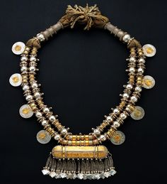 """munan15: """" Oman Silver, gold leaf, silver pointed beads, Maria Theresia thalers Late 19th century Height 50cm """""""