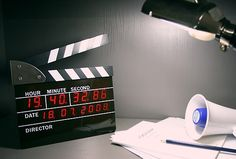 Film Action Clock. It can be hung on the wall and can also be flat on the table. LED display hours, minutes, seconds, hundredths of a second, year, with dates and alarm.