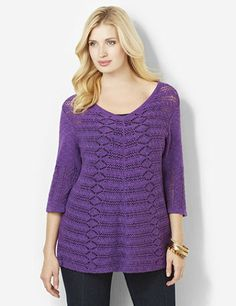 Loose, draping sweater is bound to be a favorite in your wardrobe. V-neck style comes in a delicate, crochet knit fabric with an openwork design for lightweight layering with a tank underneath. Comes in a solid knit fabric on the back. Catherines tops are designed for the plus size woman to guarantee a flattering fit. catherines.com