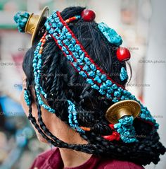 Tibetan Women wearing/selling traditional Turquoise Jewelry. Lhasa,  Capital of Tibet. South-Western Tibet 2011© Nora de Angelli / www.noraphotos.com
