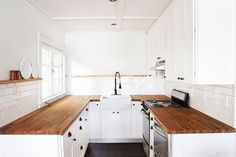 Wooden countertops have an unparalleled ability to add warmth to a kitchen. An affordable, durable option for this effect is butcher block. Butchers have used b