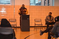Former NFL player Keon Carpenter speaks to youth at Chick Webb Recreation Center during outreach event with the Ed Block Courage Award Foundation