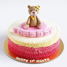 Bear and pink ruffle cake to celebrate one month baby 🎉🎉 .  .  .  .  .  .    #buttercream #buttercreamcake #cakestagram #instacake #lilbitesid #ciakholiao #kulinermedan #cakecakecake #foodphotography #food52 #f52grams #onemonthold #foodgawker #buzzfeast #eeeeeats #eatandtreats #sgbakes #goodeats #homebaked #huffposttaste #makanmana #nomnom #vscocam #bonappetit #wiltoncakes #yahoofood #onthetable #cakedecorating #wtfoodies #thekitchn