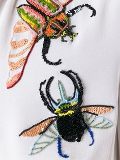 beaded insects on an alexander mcqueen dress.
