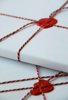 Wax Seal, white butcher paper, bakers twine