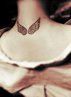Mayan style of angel wing tattoo behind the neck