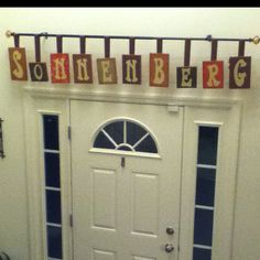 Wood blocks covered with scrapbook paper and then letters painted on. Used ribbon to hang them from a curtain rod.