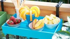 Stock this tray with refreshments from the kitchen, then carry it outside and hang it on a deck rail as a serving station, snack and beverage holder, or display shelf.