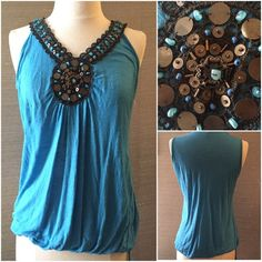 Blue tank top with sequins. Elastic hem with ties. Blue tank top with sequins. Elastic hem with ties. Robin K Tops Tank Tops