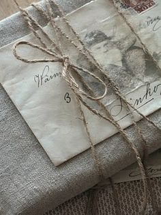 wrapped with linen, parchment, old letters and twine