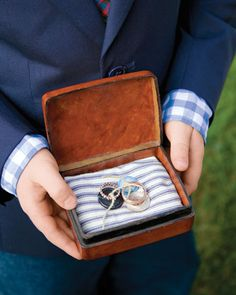 A ring bearer matches his shirt to the ring pillow