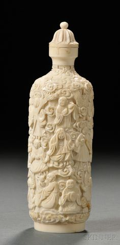 Ivory Snuff Bottle, China, carved in relief with Immortals and a dragon and tiger with scrolling clouds, stylized lotus finial, ht. 6 in.
