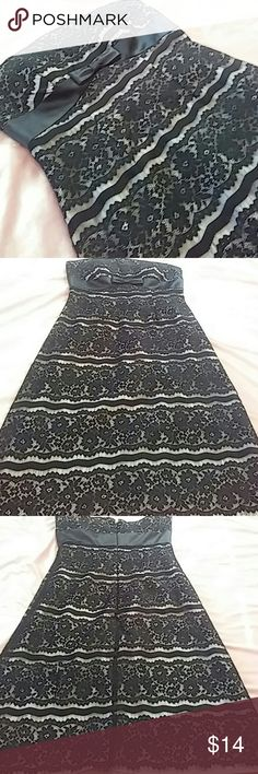 """Black and Nude Lace Dress Beautiful strapless dress with black lace over nude lining. Black satin band runs all around. Black satin bow under chest. Small repaired hole (pic 4) but in great over all condition. Back zipper. 33"""" long. Bust 15"""".  17"""" waist. Polyester. delaru Dresses Strapless"""