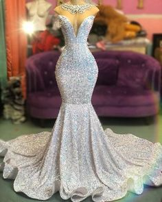 This glistering silver glitter strapless mermaid prom dress with plunging neckline and chapel is sure to fit in swimmingly at prom Black Girl Prom Dresses, Pretty Prom Dresses, Mermaid Prom Dresses, Wedding Dresses, Strapless Prom Dresses, Homecoming Dresses, Chiffon Dresses, Purple Bridesmaid Dresses, Sweet 16 Dresses