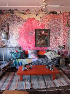 When the door opens into Martyn Thompson and Dove Drury-Hornbuckle's Soho loft, the northern light pours in to illuminate a festival of hot, juicy colors. It's very Age of Aquarius. The walls were painted by Drury-Hornbuckle.