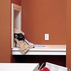 A built-in laundry chute eliminates tiresome trips down the stairs. | Photo: Nathan Kirkman | thisoldhouse.com
